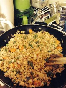 Homemade fried rice made after a phone consultation with her 81-year-old mimi and a little hands-on help from mom.